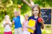 Little schoolgirl going to school — Stock Photo