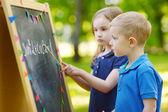 Adorable little girl playing teacher — Stock Photo
