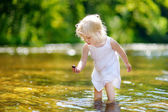 Cute toddler girl on river — Foto Stock