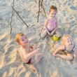 Three little kids on beach — Stock Photo #51535787