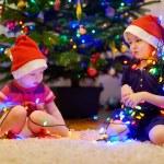 Sisters decorating Christmas tree — Stock Photo #51579059