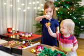 Sisters with decorations — Stock Photo