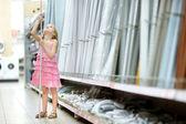 Girl in  houseware store — Stock Photo