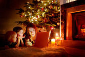 Mother and  daughters on Christmas — Stock Photo