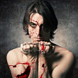 Terrible evil man with an iron chain and covered in blood. — Stock Photo