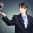 Businessman released from his hands a balloon. — Stock Photo