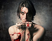 Terrible evil man with an iron chain and covered in blood. — Foto Stock