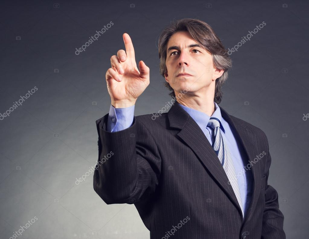 Business man pressing a touchscreen button — Stock Photo #14013887