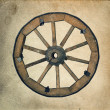 Old wooden wheel — Stock Photo