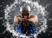 Swimmer jumps into the water. — Stock Photo
