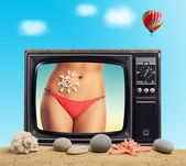 Body is tanned woman in retro TV — Stock Photo