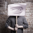 A man with a great eye for a head. — Stock Photo