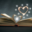 Pages of a book curved into a heart shape — Stock Photo #27159627
