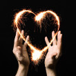Fiery heart of a person's palm. — Stock Photo