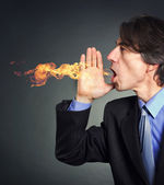 From the mouth of a man a fire erupts. Men suffering from heartburn. — Stock Photo