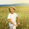 Boy running on summer field — Stock Photo