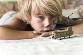 Boy plays with a helicopter — Stock Photo