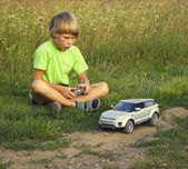 Boy played with a radio-controlled car — Stock Photo