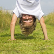 Boy stands upside down — Stock Photo