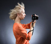 Girl c with flying hair photographing — Stock Photo