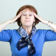Woman with a headache — Stock Photo #30107555