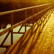 Wooden bridge over river — Stock Photo #30283459