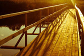 Wooden bridge over the river — Stock Photo