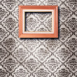 Ornate wooden frame at grunge wallpaper — Stock Photo #30595979