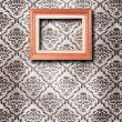 Ornate wooden frame at grunge wallpaper — Stock Photo