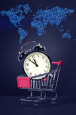 Shopping Cart with Alarm Clock and map — Stock Photo