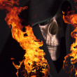Scary skull and flames of fire. — Photo