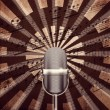 Microphone  with notes background — Stock Photo