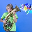 Stock Photo: Boy playing on saxophone