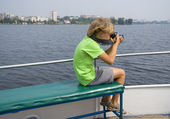Boy photographing on the ship — Stock Photo