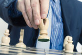 Business man moving chess figure — Stock Photo