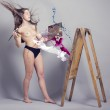 Topless woman painting a picture — Stock Photo #35928837