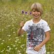 Little boy with a bouquet of wildflowers — Stock Photo