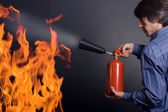 Man with extinguisher — Stock Photo