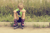 Boy on roller skates — Stock Photo