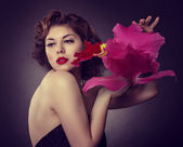 Woman with a big red flower — Photo