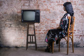 Woman and old television — Stock Photo