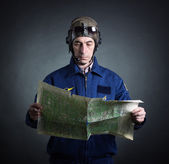 Pilot with a geographical map — Stock fotografie