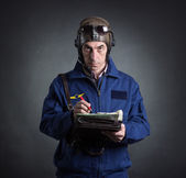 Pilot with a geographical map — Stock Photo