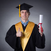 Man in an academic cap  with diploma — Stock Photo