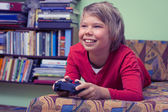 Boy teenager with remote control — Stock Photo