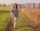 Girl walking on summer field — Stock fotografie