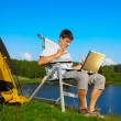Man with laptop outdoor — Stock Photo #12565130