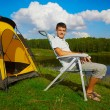 Man at the campsite - Stock Photo
