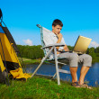 Man with laptop outdoor — Stock Photo
