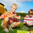 Boys eating watermelon outdoors — Stok fotoğraf